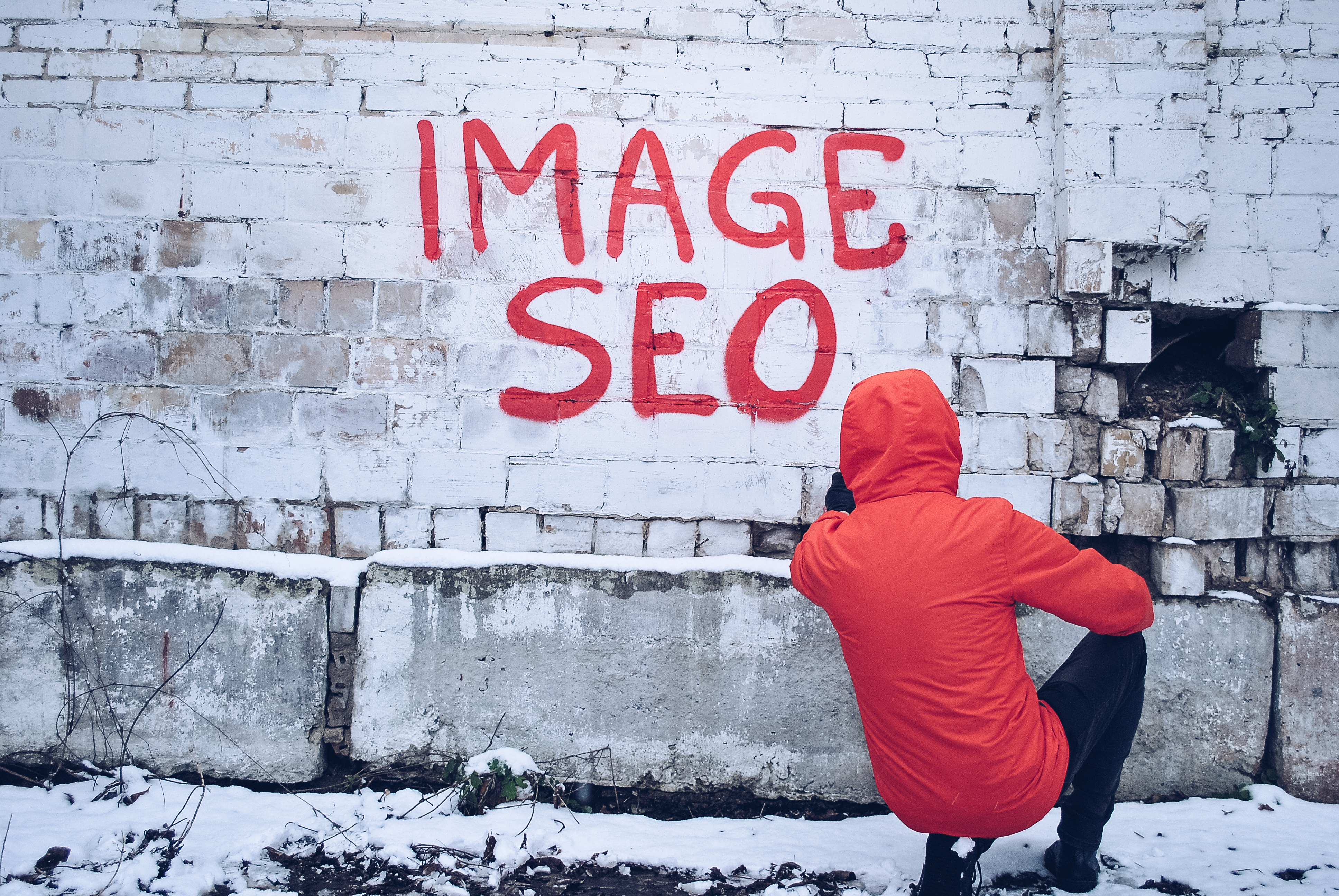 Image SEO graffiti painted by person on a brick wall